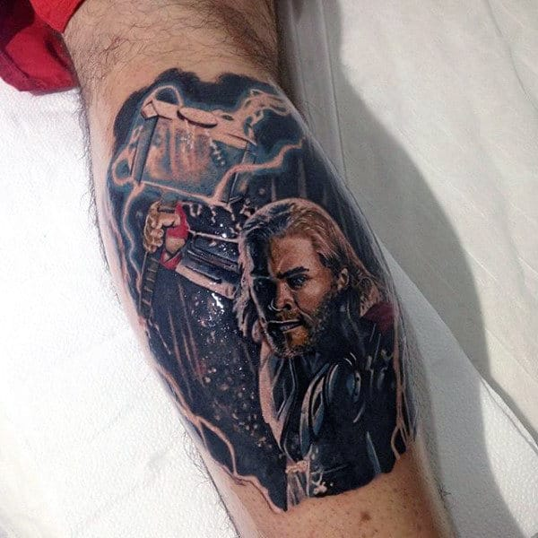 Man With Tattoo Of Thor And Mjolnir On Leg Calf