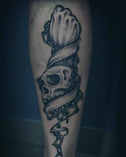 Man With Tattoos Chains Of Skull And Hand