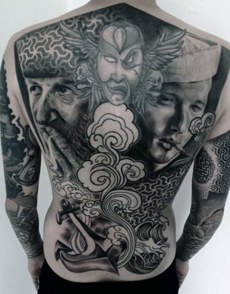 Man With Tattoos Of Sailors On Back