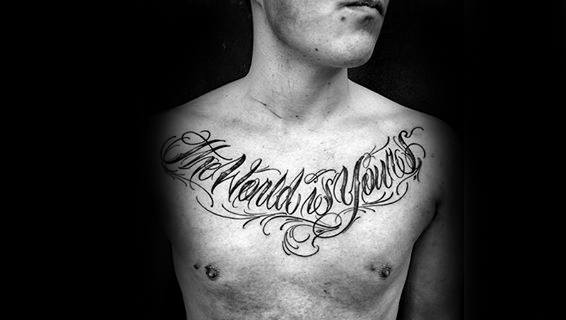 Man With The World Is Yours Script Decorative Upper Chest Tattoo Design