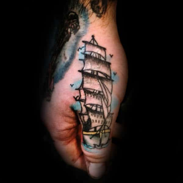 Man With Thumb Tattoo Of Sailing Ship At Sea