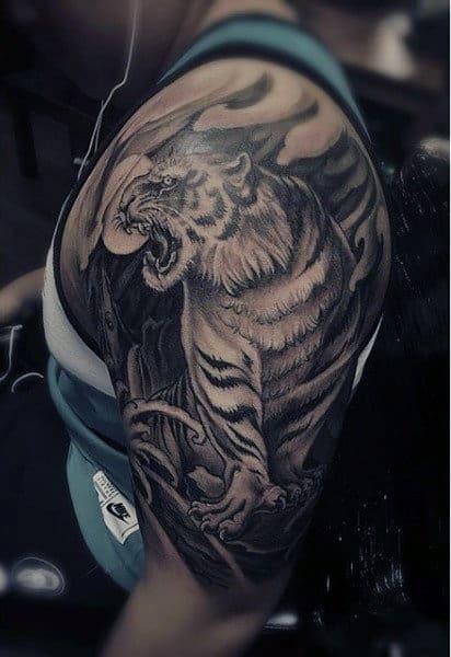 Man With Tiger Tattoo Arm
