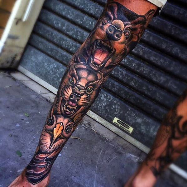 Man With Totem Pole Animals Shin Tattoo Sleeve