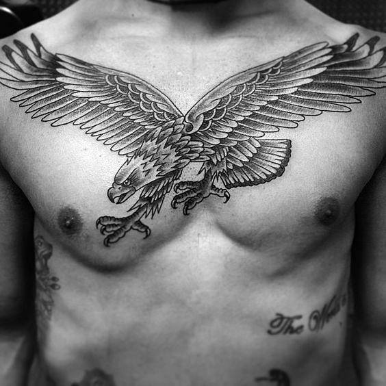 Man With Traditional Eagle Tattoo On Chest