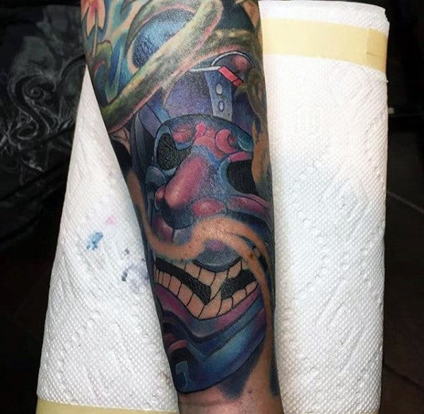 Man With Traditional Laughing Samurai Mask Half Sleeve Tattoo