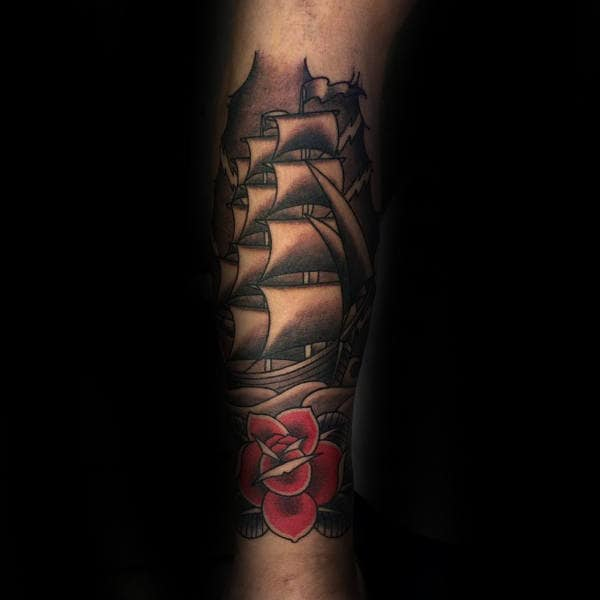 Man With Traditional Shaded Ship Leg Sleeve Tattoo
