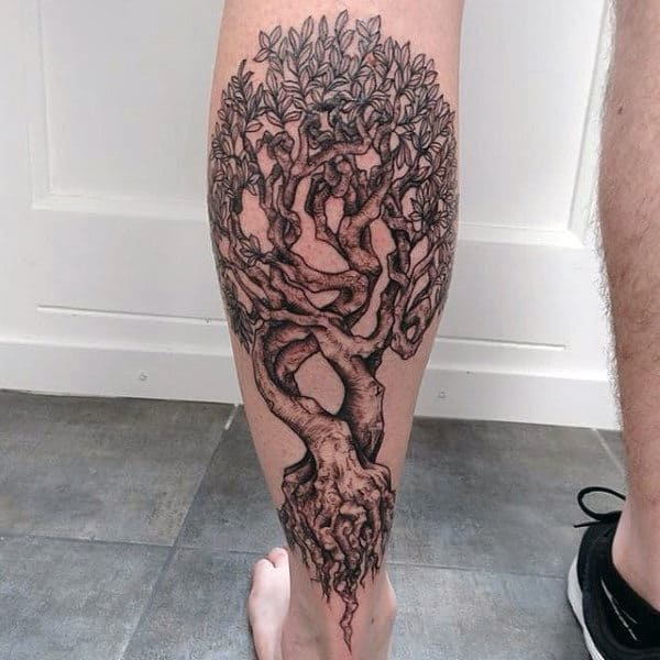 Man With Tree Roots Tattoo On Back Of Leg
