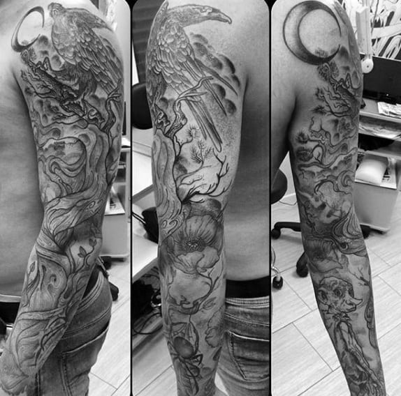 Man With Tree Sleeve Tattoo In Black And Grey Shaded Ink