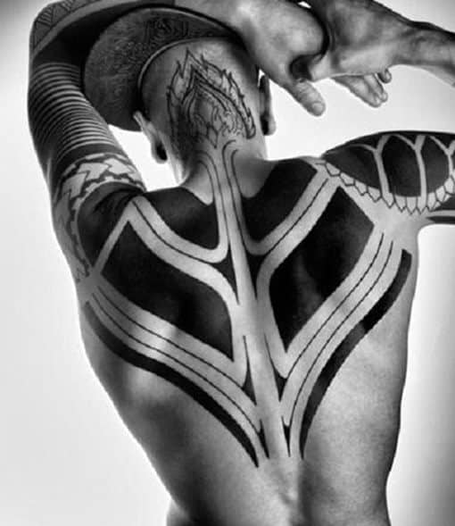 Man With Tribal Back Shoulder Tattoo