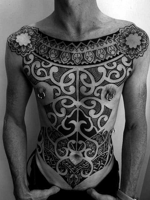 Man With Tribal Chest Arm Tattoo