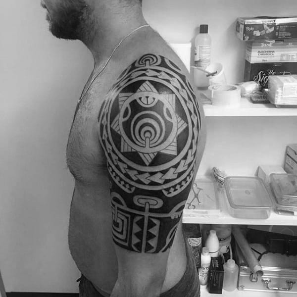 Man With Tribal Tattoo On Arm Half Sleeve