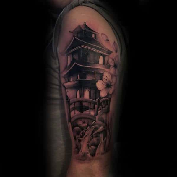 Man With Upper Arm Bridge Japanese Temple Tattoo