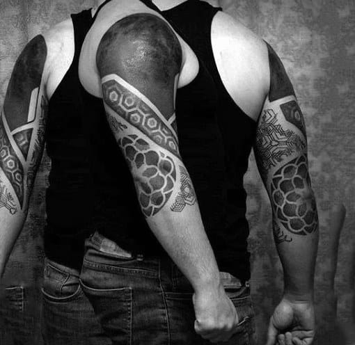 Man With Upper Arm Half Sleeve Blackwork Tattoo Design