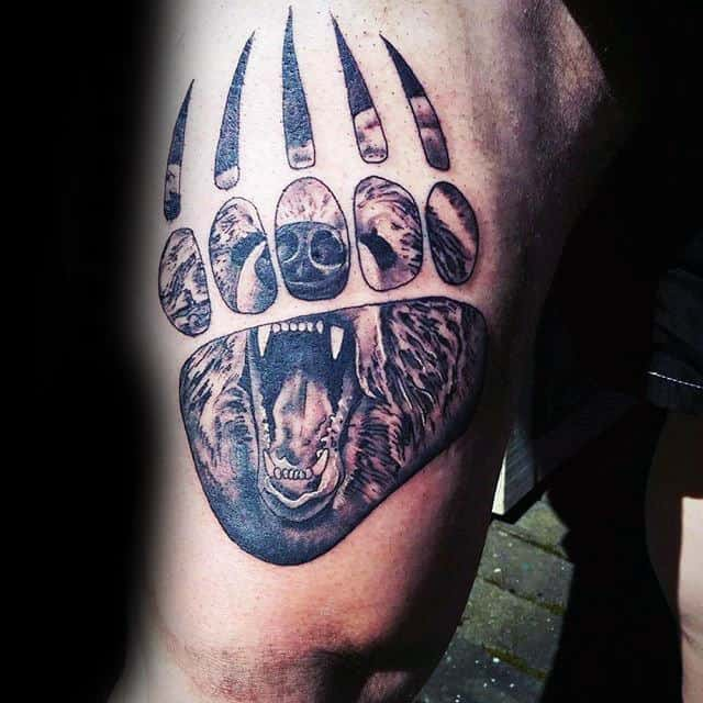 Man With Upper Thigh Tattoo Of Bear Claw