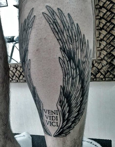 Man With Veni Vidi Vici Angel Wings Leg Tattoo
