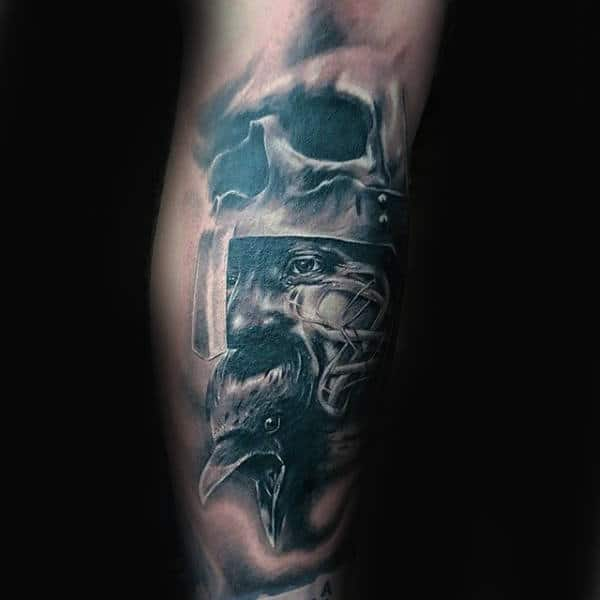 Man With Warrior Crow Arm Tattoo