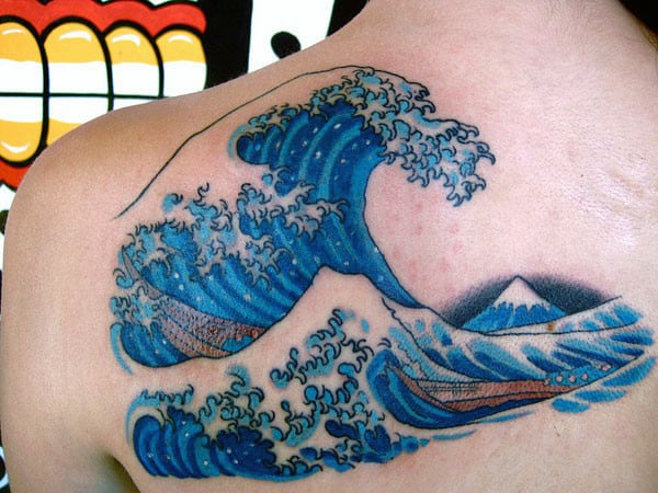 Man With Water Wave Tattoo On Back