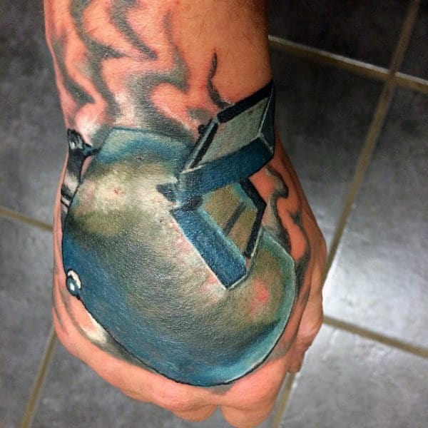 Man With Welding Helmet Tattoo On Hand