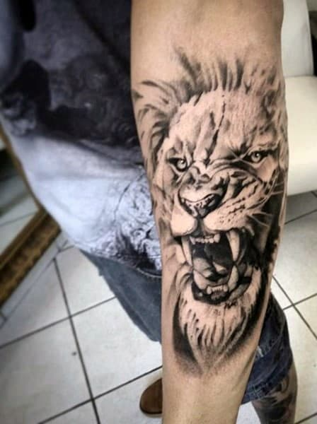 Man With White And Grey Ink Outer Forearm Lion Tattoo Design