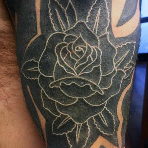 Man With White Ink Rose Over Black Tattoo On Leg Thigh