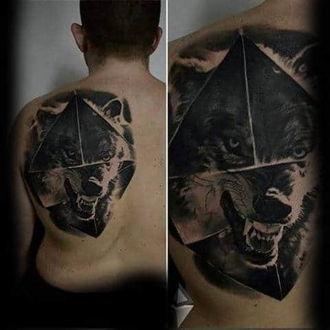 Man With Wolf Animal Back Tattoo Abstract Design