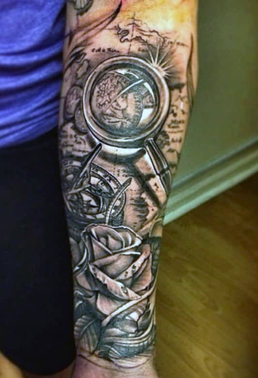 Man With World Map And Magnifying Glass Half Sleeve Forearm Tattoo