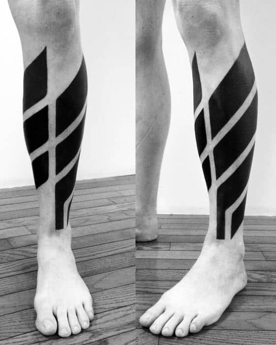 Manly All Black Negative Space Leg Tattoos For Guys