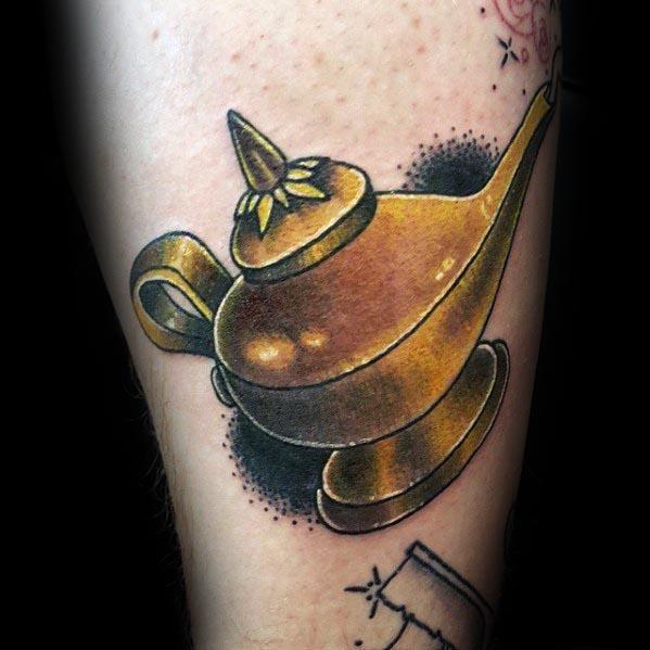 Manly Gold Arm Genie Lamp Tattoo Design Ideas For Men