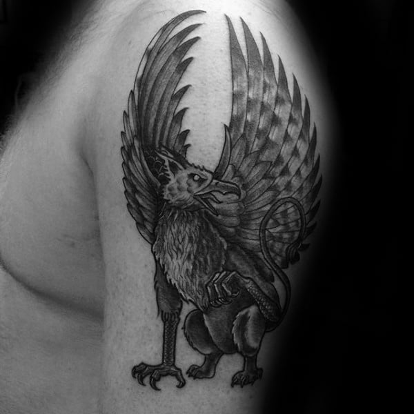 Manly Guys Upper Arm Tattoo Of Griffin Design