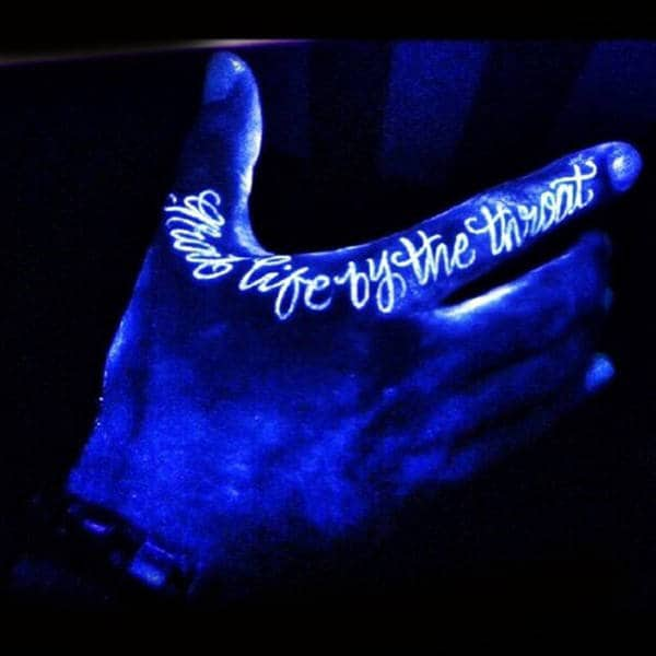 Manly Lettering Glow In The Dark Hand Tattoo With Grab Life By The Throat Wording