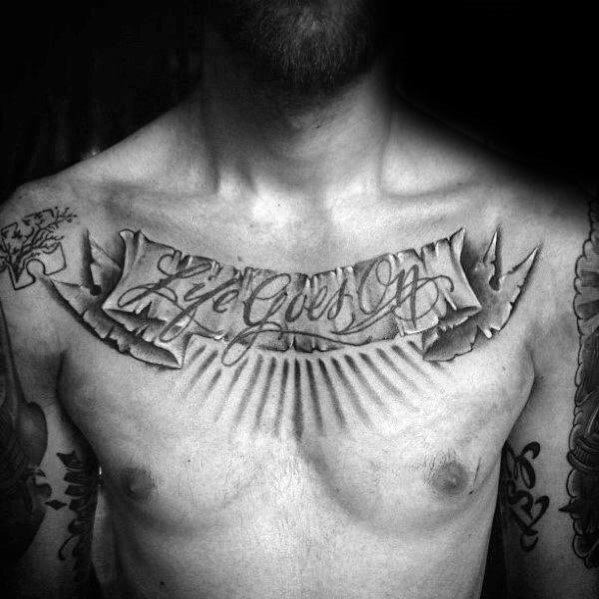 Manly Life Goes On Banner Chest Tattoo Design Ideas For Men