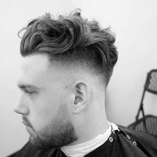 Manly Medium Wavy Hairstyles For Men With High Fade
