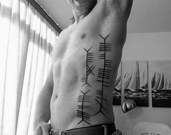 Manly Ogham Tattoo Design Ideas For Men Rib Cage Side Of Body