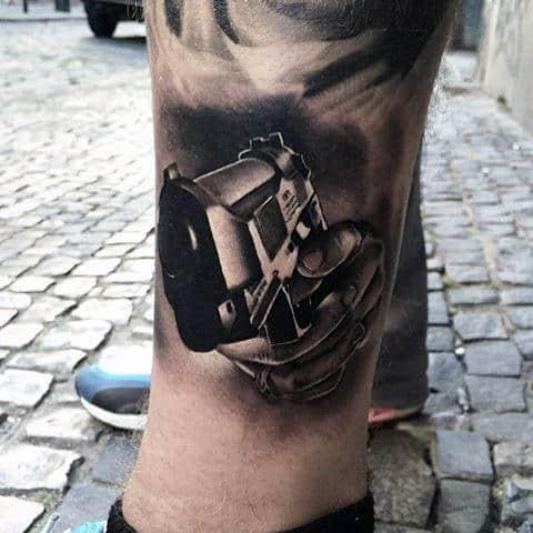 Manly Tattoo Gun Designs On Legs
