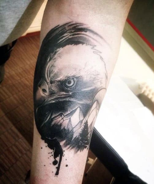 Mans Horrific Black Bald Eagle Tattoo On Forearms
