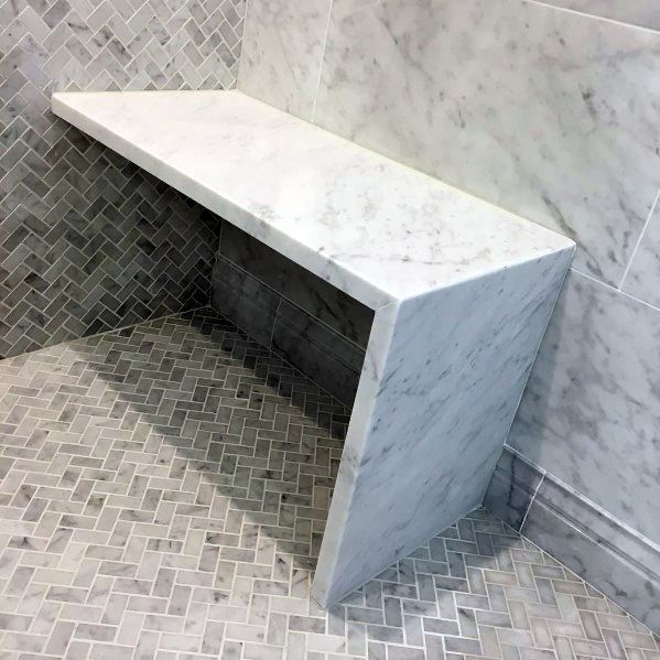 Marble Shower Bench Seat Ideas With Herringbone Tile Flooring