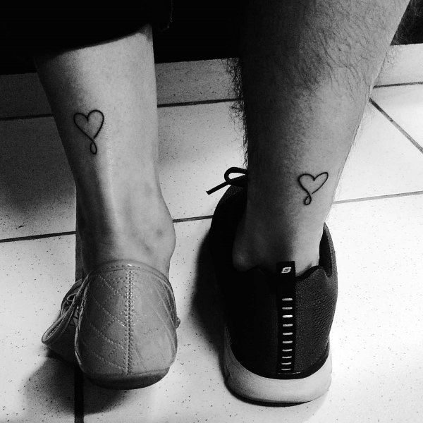 Married Couple Tattoos Small Design Heart On Back Of Lower Legs