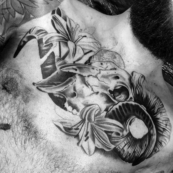 Masculine Animal School Tattoo On Chest For Men