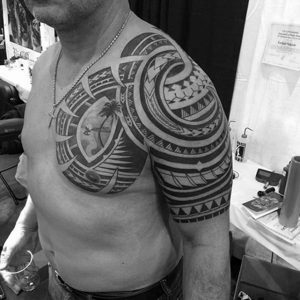 Masculine Badass Tribal Upper Chest And Half Sleeve Tattoos For Men