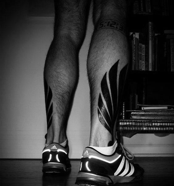 Masculine Bold Black Ink Hermes Wing Leg Tattoo Ideas