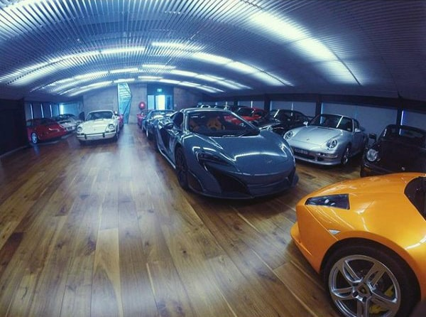 Masculine Dream Garage Design With Wood Flooring And Exotic Cars