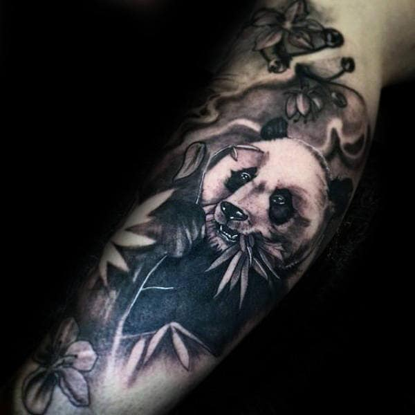 Masculine Forearm Panda Bear Chewing Plant Tattoo For Men