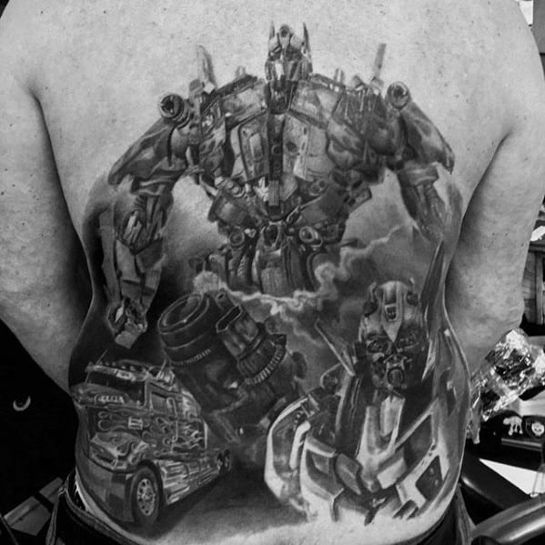 Masculine Shaded Black And Grey Guys Themed Transformers Tattoo On Back