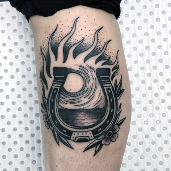 masculine-traditional-horseshoe-sun-ray-portal-mens-leg-tattoo