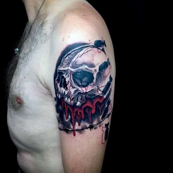 Masculine Trash Polka Skull Tattoo On Upper Arm For Guys