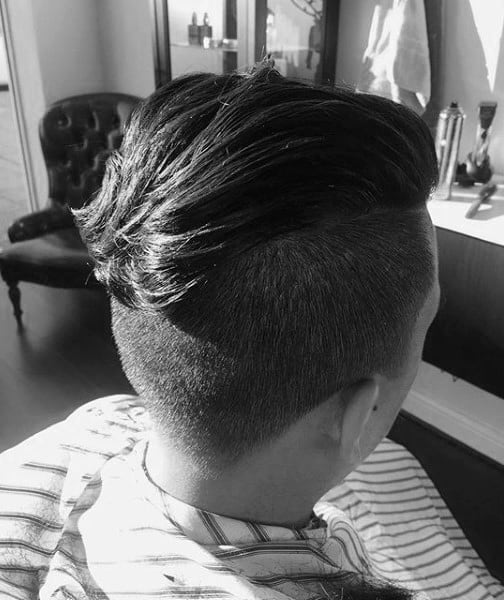 Masculine Undercut Slicked Back Style For Men With Thick Hair