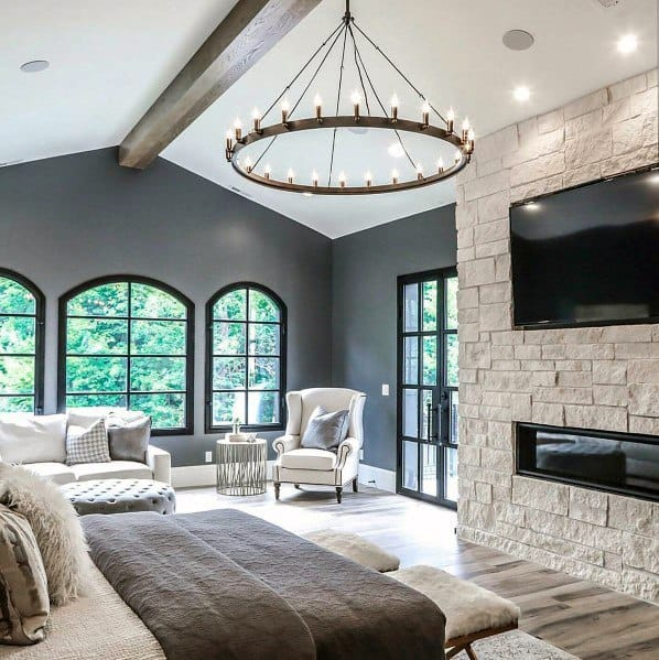 Master Bedroom Ideas With Hardwood Floors And Stone Fireplace