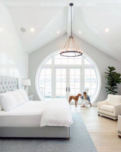 top 70 best vaulted ceiling ideas high vertical space 16139 | master bedroom vaulted ceiling design idea inspiration with giant circle window