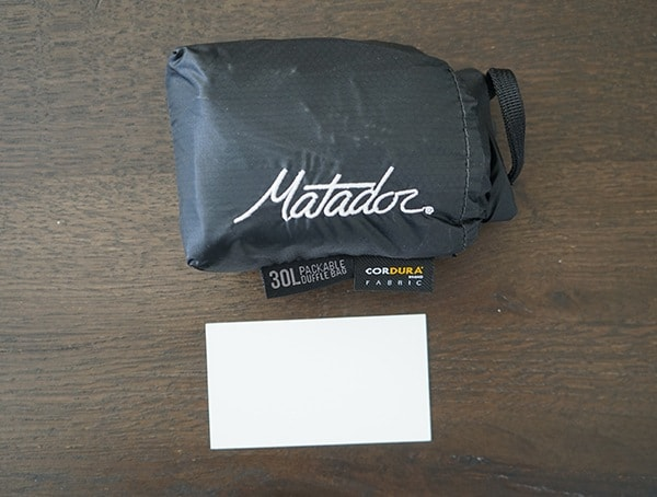 Matador Transit30 Compact Duffle Bag Business Card Size Comparison