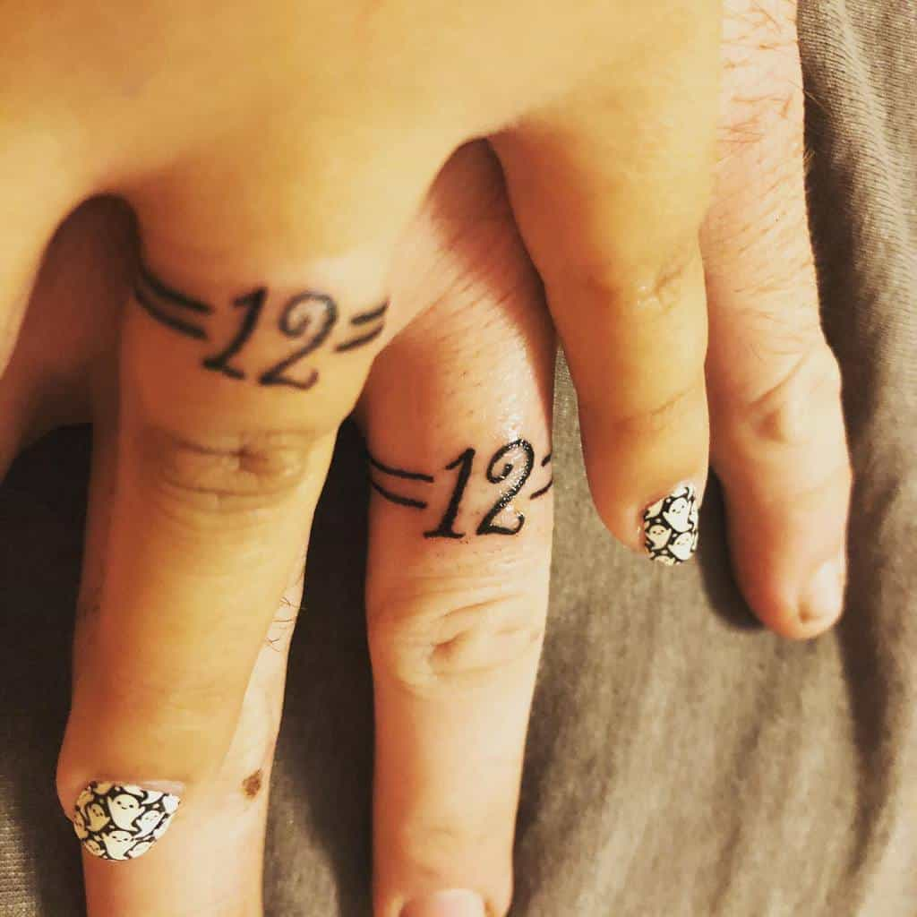 Matching Themed Wedding Ring Tattoo Alicia Johnson74